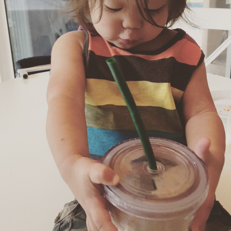 my brain washed 2 year old devouring her spinach kale banana raw cacao shake